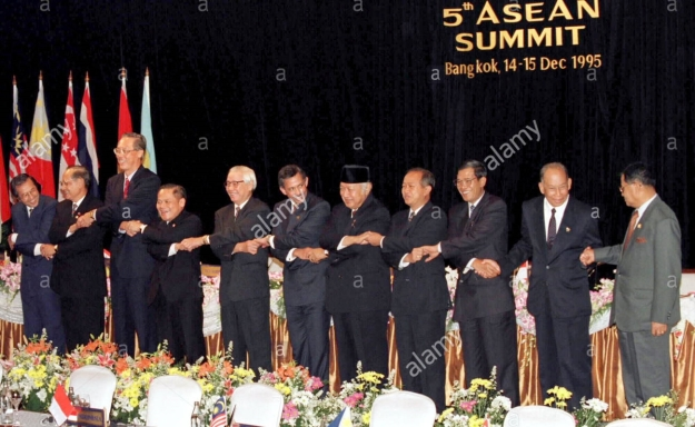 Leaders of the seven Association of Southeast Asian Nations join hands with the heads
